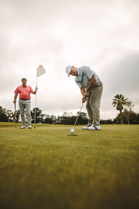 Professional golfers playing golf together on the course