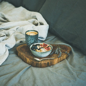 Rice coconut porridge and espresso in bed square crop