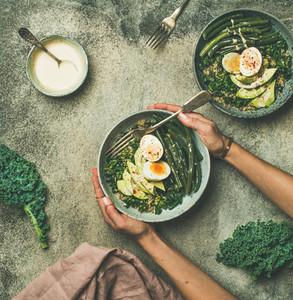 Quinoa  kale  beans  avocado  egg bowls  top view