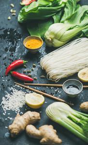 Asian cuisine ingredients over dark slate stone background selective focus