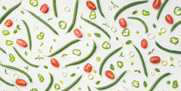 Fresh green beans and cherry tomatoes over white background