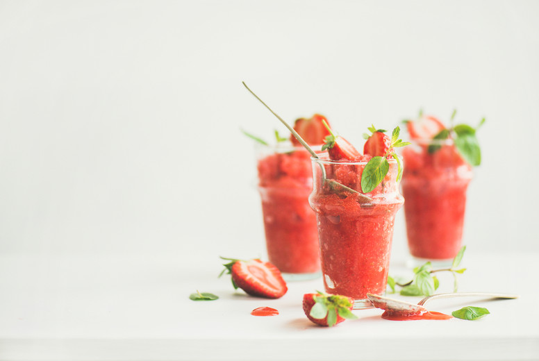Strawberry  champaigne summer granita in glasses  copy space