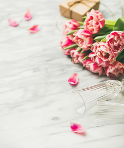 Pink tulips champaign glasses and gift box with copy space
