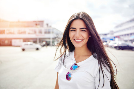 Beautiful woman with sunglasses on shirt