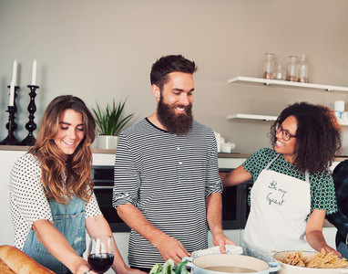 Three friends having a cooking party