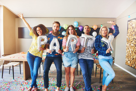 Happy group holding PARTY letters