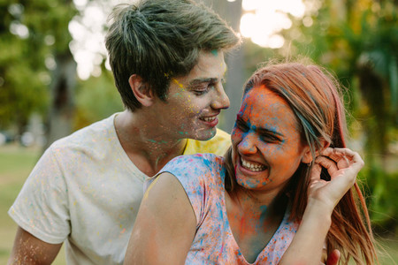 Couple playing holi outdoors