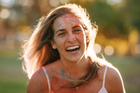 Portrait of a woman enjoying holi