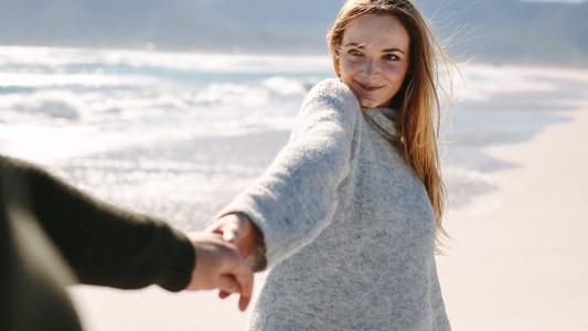 Couple enjoying a walking on beach