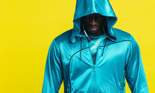 African man in a fitness hoodie
