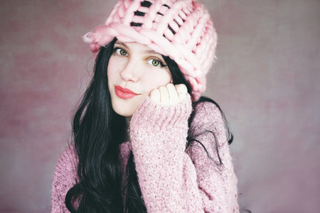 Beautiful and expressive brunette woman in pink