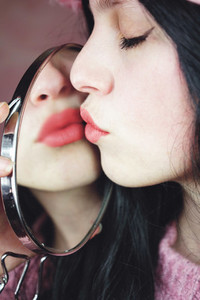 Beautiful young brunette woman kissing