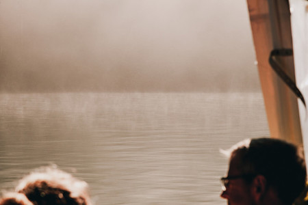views from a boat of the border of the lake among fog