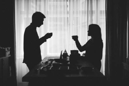 Silhouettes of couple drinking