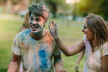 Happy couple playing holi