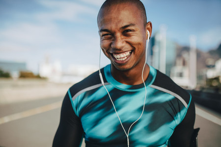 Fit young runner with a broad smile