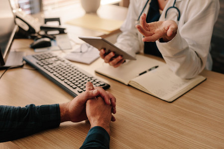 Female doctor consulting male patient