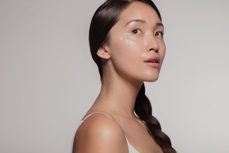 Woman trying out new cosmetic cream