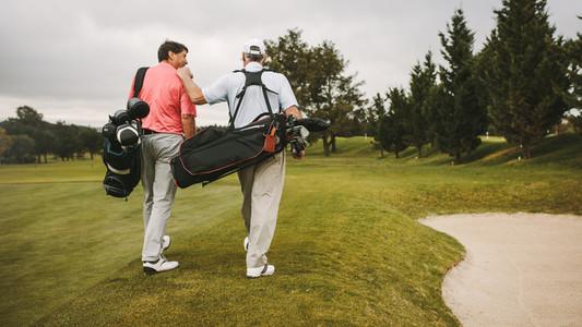 Senior golfers walking towards the next hole