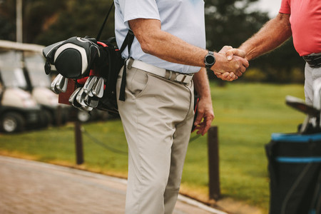 Golfers greeting each other with a handshake