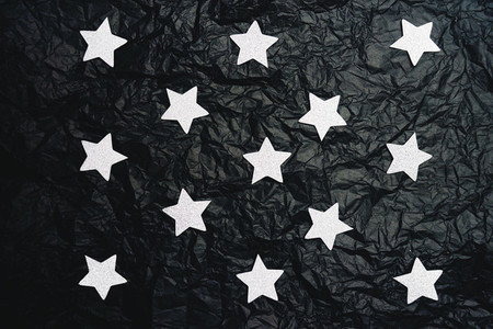 Fake sky night doing with silver stars and crumpled black paper