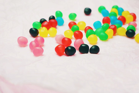 A lot of jelly candy against pale pink background