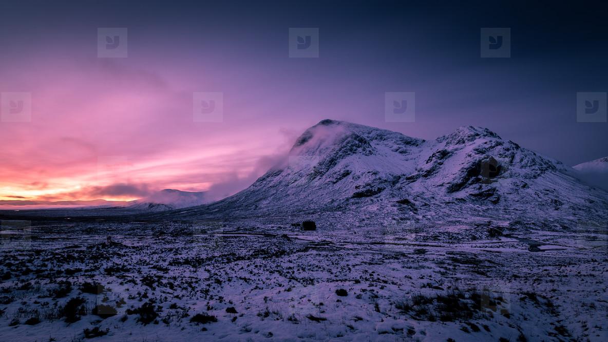 Sunrise winter snow mountain landscape in Glencoe Scotland