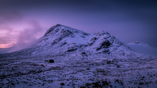 Sunrise winter snow mountain landscape in Glencoe Scotland