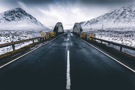 Open road winter snow mountain landscape in Glencoe Scotland