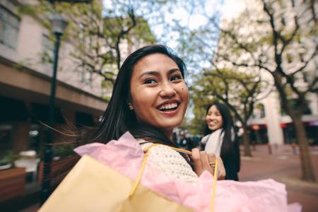 Happy asian women having fun shopping