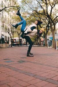 Happy women having fun in the street