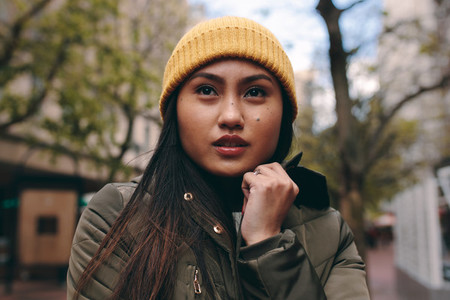 Close up of an asian woman in winter clothes