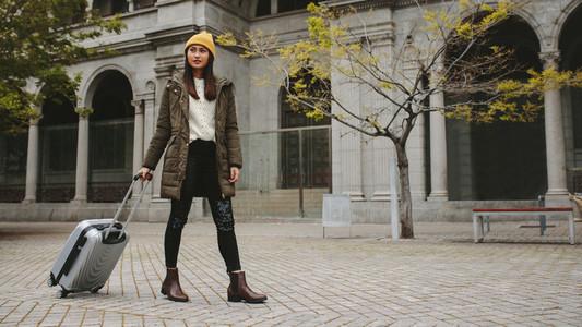 Woman tourist walking on street