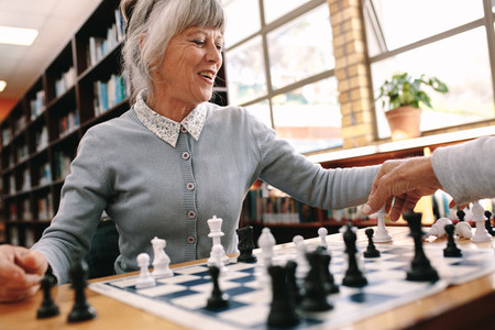 Close up of a woman playing chess