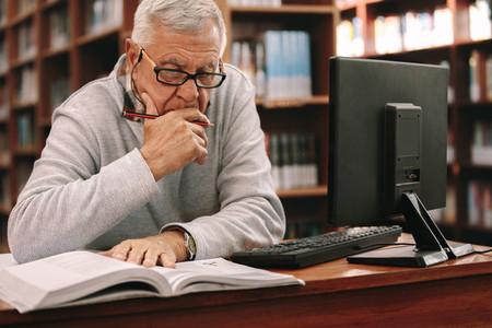 Senior man studying in classroom