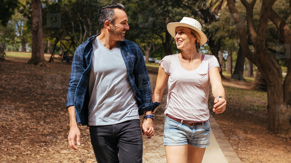 Smiling couple in love walking in the park