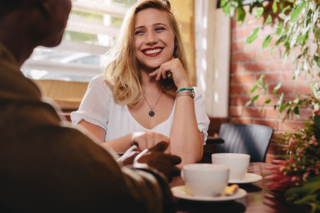 Dating couple spending qualtiy time at coffee shop