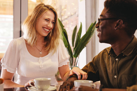 Smiling woman meeting her friend at a coffee shop