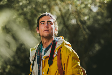 Portrait of a hiker standing in a forest