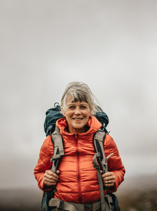 Portrait of a female hiker walking carrying a backpack