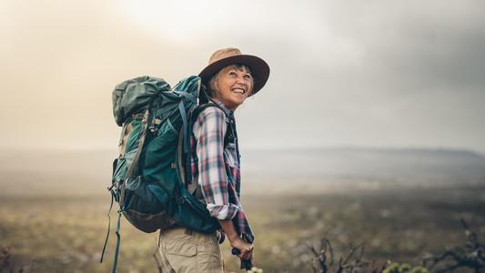 Portrait of an excited female trekker