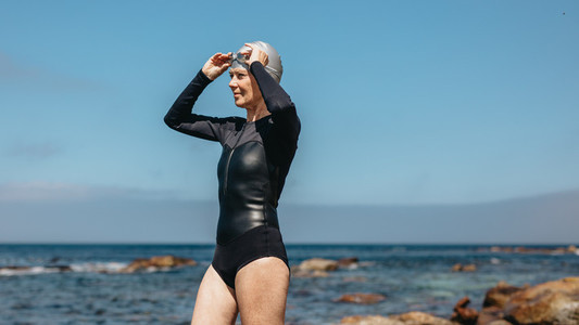Woman swimmer standing near the sea