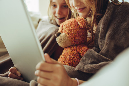 Girls watching a movie on a tablet pc