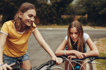 Girls on bicycles in the street