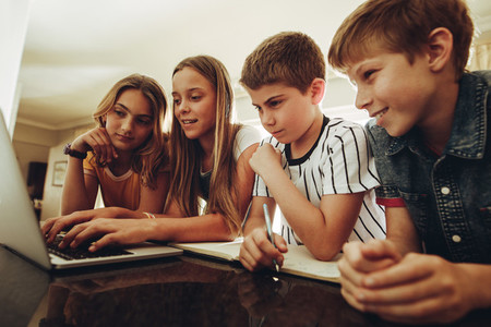 Kids learning together on a laptop