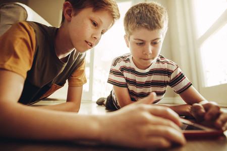 Boys using tablet pc