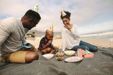 Beautiful family having party at the beach