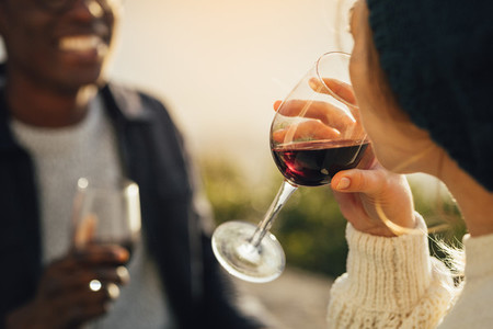 Woman drinking wine on picnic with boyfriend