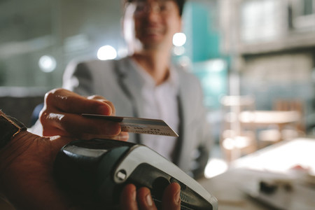 Businessman paying with contactless credit card