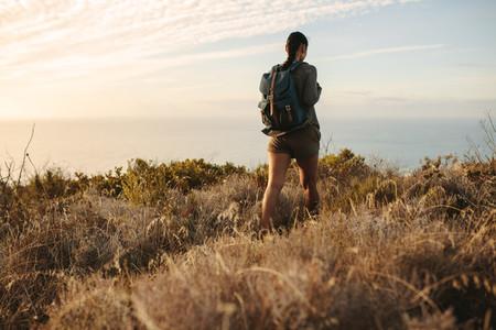 Woman walking on a mountain trail